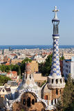 City of Barcelona from Park Guell. Rooftops and spires of porter's lodge pavilions by Antoni Gaudi in Park Guell, Barcelona, Catalonia, Spain Stock Photography