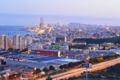 City of Barcelona suburb with warehouses at dusk royalty free stock photos