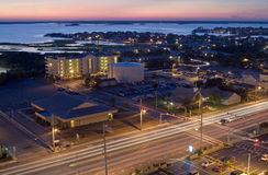 City by the bay. Night scene of Ocean City, Maryland and bay stock photos