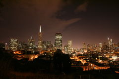 City by the Bay. Downtown view of San Francisco at night from Coit Tower hill Royalty Free Stock Photo