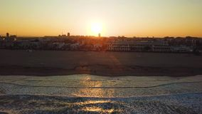 Views from drone during sunset on beach Malvarrosa in Valencia. City, bay and port view during golden hour in beautiful place stock footage