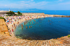 City beach of Antibes, Cote Azur, France. Antibes, France - July 24, 2016: city beach of Antibes with unidentified people. Antibes is a Mediterranean resort in royalty free stock photos