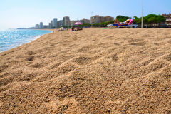 City beach in Spain. People sunbathing on the sandy beach in Spain Stock Images