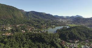 A city with a beautiful lagoon. City with a beautiful lagoon in the mountain. The city of Teresopolis, State of Rio de Janeiro, Brazil, South America stock video footage