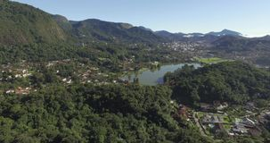 A city with a beautiful lagoon. City with a beautiful lagoon in the mountain. The city of Teresopolis, State of Rio de Janeiro, Brazil, South America stock footage