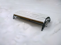 City bench covered with snow Royalty Free Stock Photography
