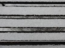 CITY BENCH IN SNOW, WHITE SNOW stock photography