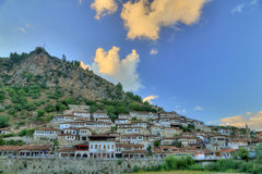 City of Berat in Albania. Historic city of Berat in Albania at late afternoon with white houses gathering on a hill. It's also called city of a thousand windows Stock Photo