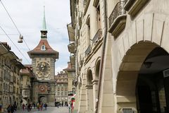In the city of Bern the Zytglogge is seen. Bern, Switzerland - April 17, 2017: In the old town the Zytglogge is seen at the end of a street. This medieval tower Royalty Free Stock Images