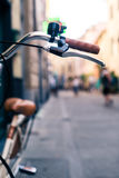 City bicycle handlebar, bike over blurred beautiful bokeh backgr Stock Photography