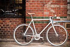 City bicycle on red wall, vintage Stock Photography