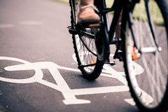 City bicycle riding on bike path Royalty Free Stock Images