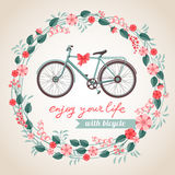 City bicycle. Vintage postcard with the bicycle in floral wreath Royalty Free Stock Photography
