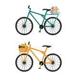 Bicycles with baskets full of male envelopes and fresh vegetables. City bicycles with colorful frame and baskets full of male envelopes and fresh vegetables Stock Images