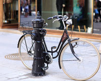 City bike. Old casual bike near water pump Royalty Free Stock Images