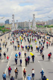 City bike festival. Mass urban cycling marathon. Cyclists go to the bridge, back to us. Concept of modern lifestyle. Healthy lifestyle. Selective focus royalty free stock photos