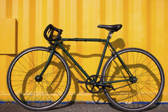 City bike fixedgear on a yellow background Stock Image
