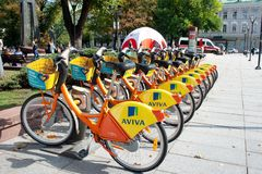City Bike Rental - A row of bikes parked for hire stock photography