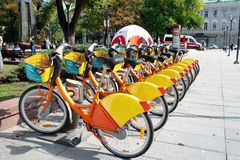 City Bike Rental - A row of bikes parked for hire royalty free stock images
