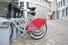 City bike vacation station by rainy day Royalty Free Stock Photos