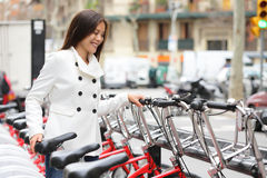 City bike - woman using public city bicycles Stock Image