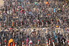 City bikes. Hundreds of bikes stalled in a row on the street in the city Deventer, the Netherlands royalty free stock image