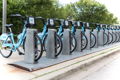 City bikes rent parking in Chicago, Illinois. Chicago, IL, USA - June18, 2017. A slender row of bicycles on  bicycle parking Royalty Free Stock Photography