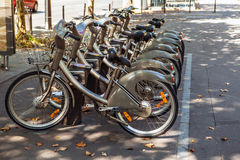 City bikes for rent on parking in Paris, France Royalty Free Stock Images