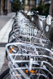 City bikes for rent on parking in Paris, France Stock Photography