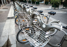 City bikes for rent on parking in Paris, France Royalty Free Stock Image