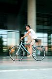City biking. Man on a bike in the city royalty free stock image
