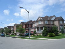 City block of brick houses. A commom look of row housing in Ontario, Canada Stock Image