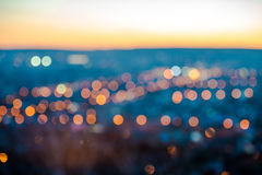 City blurring lights abstract circular bokeh on blue background Royalty Free Stock Images