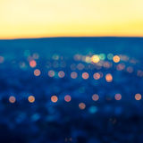City blurring lights abstract circular bokeh blue background wit Stock Photos