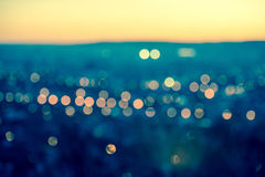 City blurring lights abstract circular bokeh on toned blue backg Stock Photography