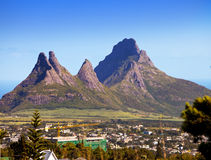 City at the bottom of mountains. Mauritius Stock Photos