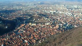City of Brasov from Tâmpa mountain, Romania, aerial footage. View of Brasov from the Tâmpa mountain showing the old and the new part of the city , with the stock footage