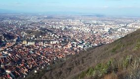 City of Brasov from Tâmpa mountain, Romania. View of Brasov from the Tâmpa mountain showing the old and the new part of the city , with the main square and stock video