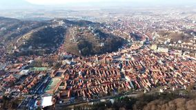 City of Brasov from Tâmpa mountain, Romania. View of Brasov from the Tâmpa mountain showing the old and the new part of the city , with the main square and stock video footage