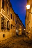 Bratislava Old Town Street At Night. City of Bratislava at night in Slovakia, narrow street and houses in the Old Town Stock Photo