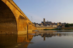 City Bridge. Old City Bridge in France with cathedral in the background royalty free stock photo