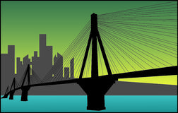 City And a Bridge. A suspenstion bridge linking to a city Royalty Free Stock Image