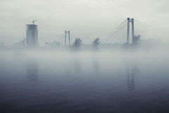 City and bridge in fog Stock Images