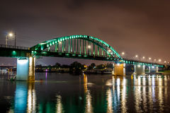 City bridge at night with reflection in water Stock Image