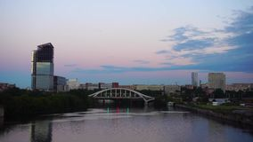 City Bridge Over River At Sunset 4K. City Bridge Over River 4K. Moscow. Business Center Buildings Near River At Sunset stock video footage