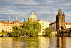 City bridge view. Photo shows the bridge, river and some old houses in Prague stock images