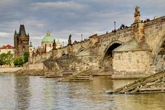 City bridge view. Photo shows the bridge, river and some old houses in Prague stock image