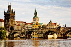 City bridge view. Photo shows the bridge, river and some old houses in Prague Royalty Free Stock Images