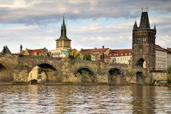 City bridge view. Photo shows the bridge, river and some old houses in Prague Royalty Free Stock Photos