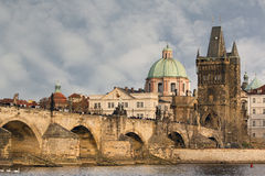 City bridge view. Photo shows the bridge, river and some old houses in Prague Royalty Free Stock Photography